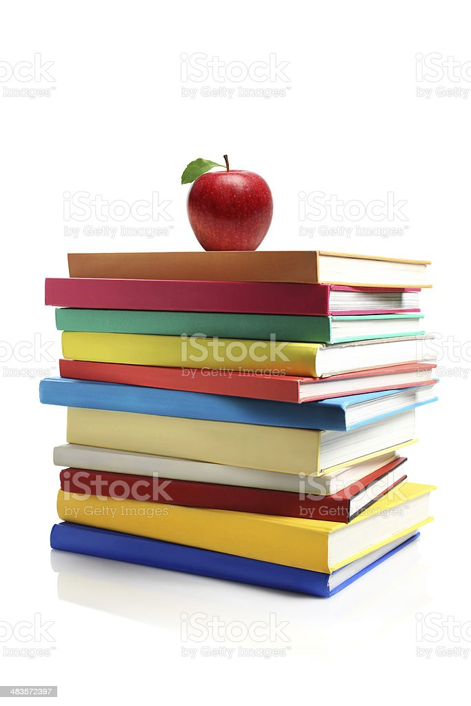 Apple on a Stack of Book stock photo