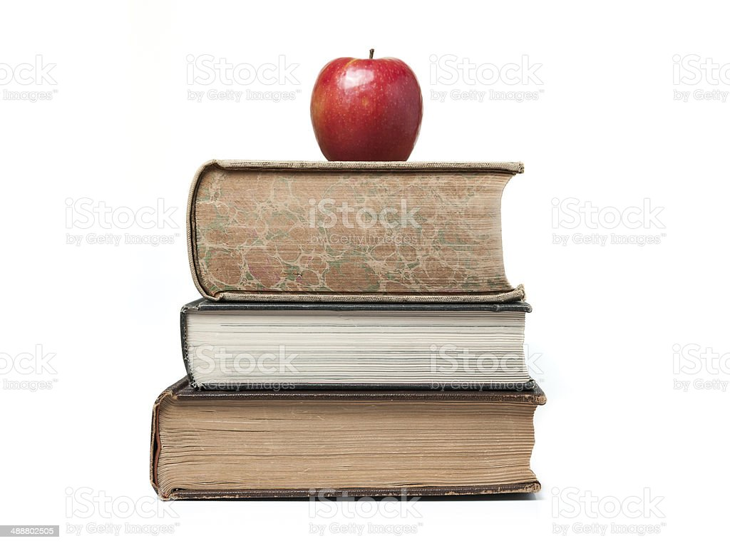 Apple on a stack of used text books royalty-free stock photo