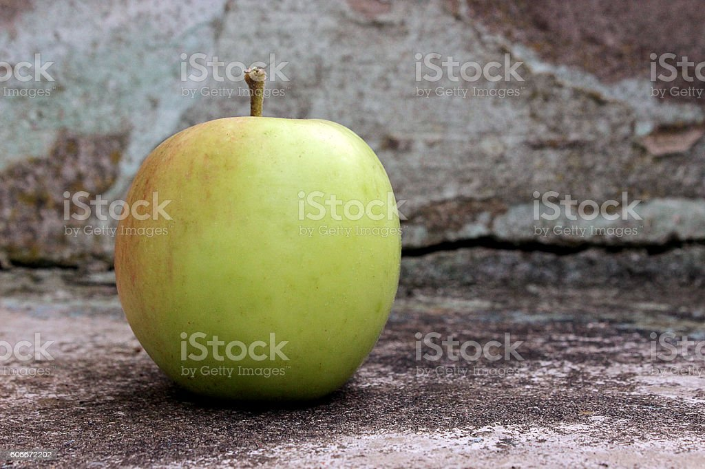 Apple on a wooden stair stock photo