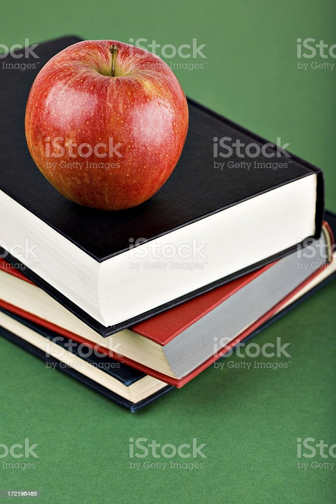 Apple on books stock photo