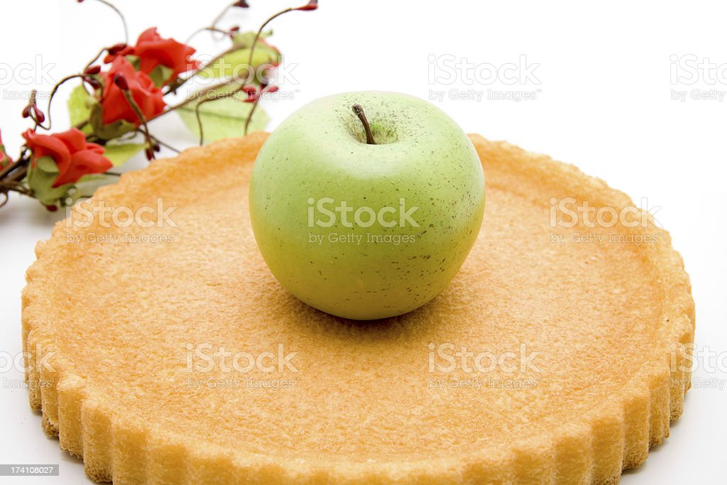 Apple on flan case and flower stock photo