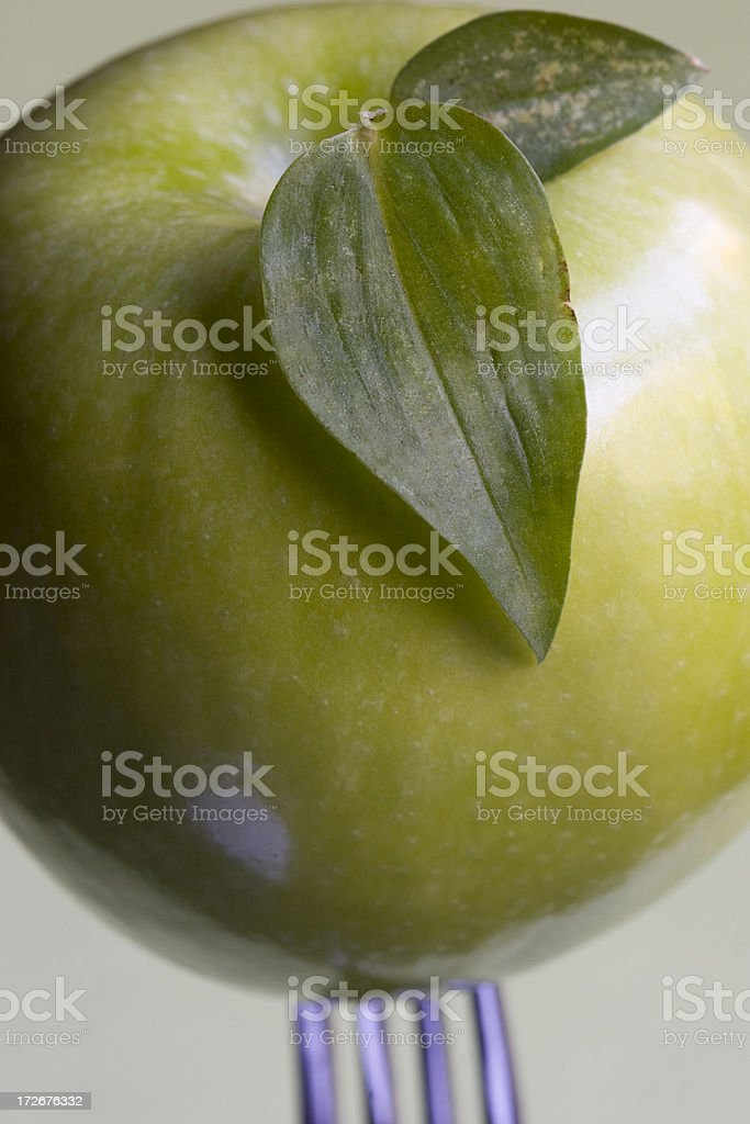 apple on fork royalty-free stock photo
