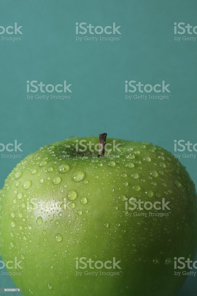 Apple on green background royalty-free stock photo