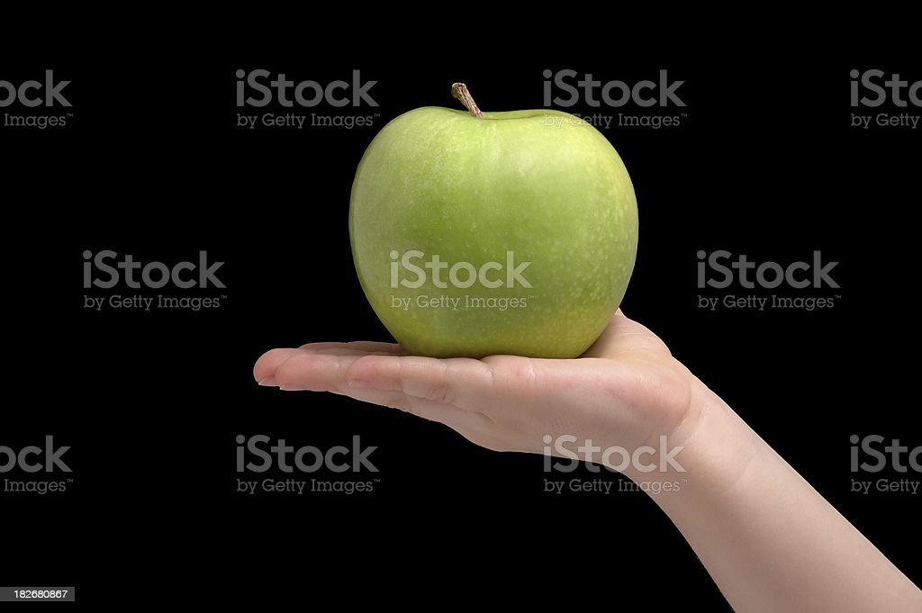 apple on hand royalty-free stock photo