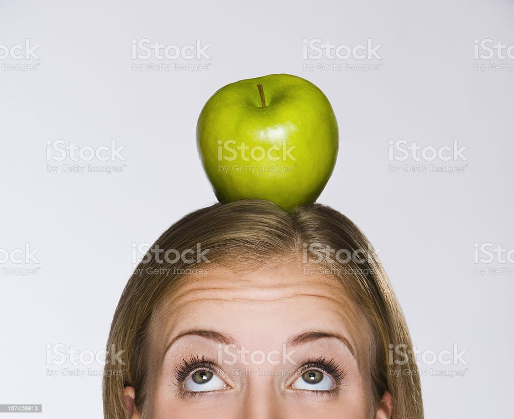 Apple on head royalty-free stock photo