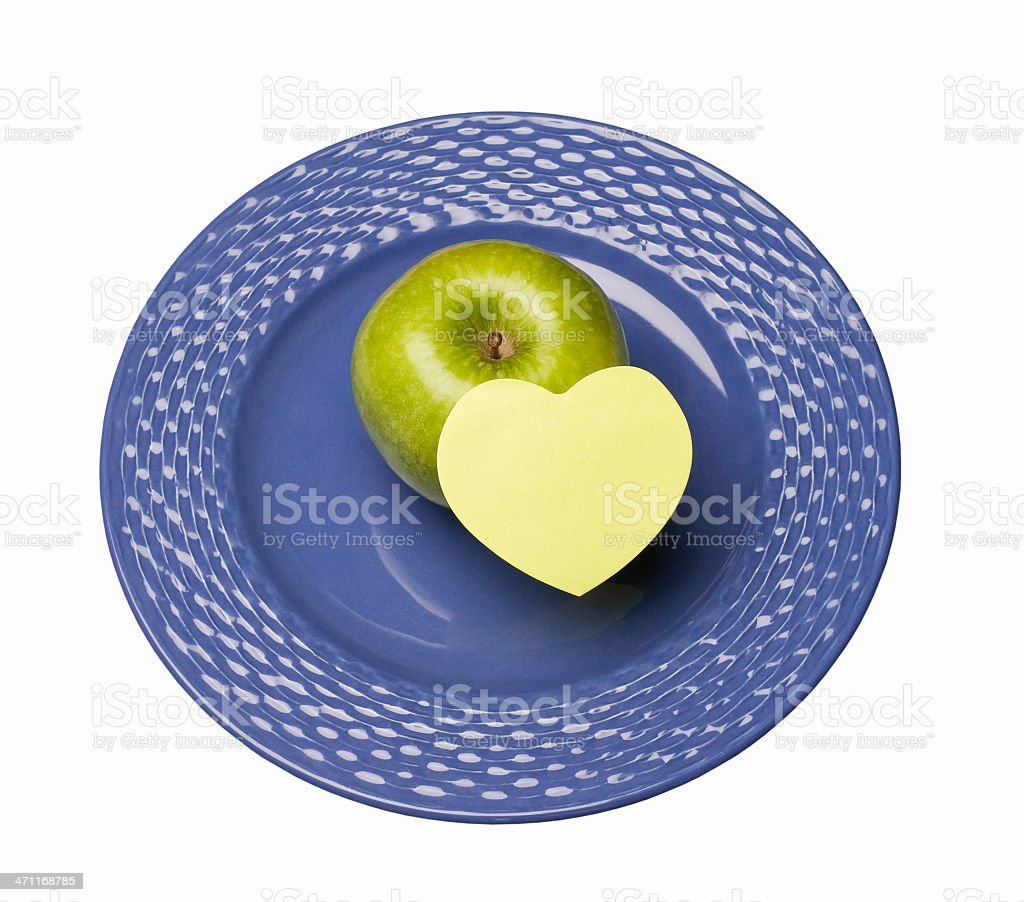 Apple on plate with note pad royalty-free stock photo