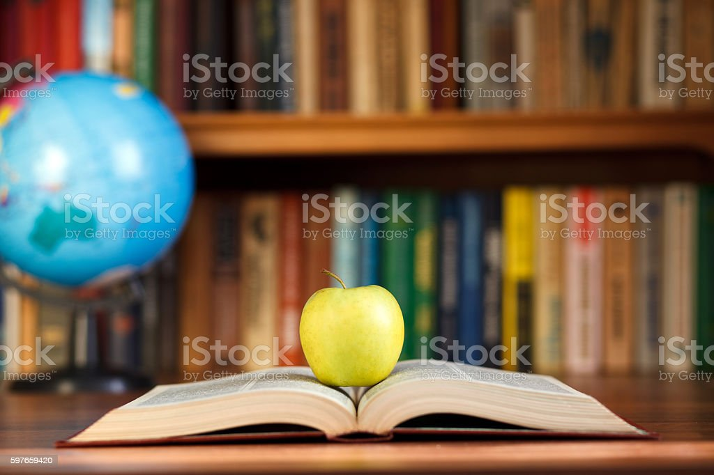 apple on the book stock photo