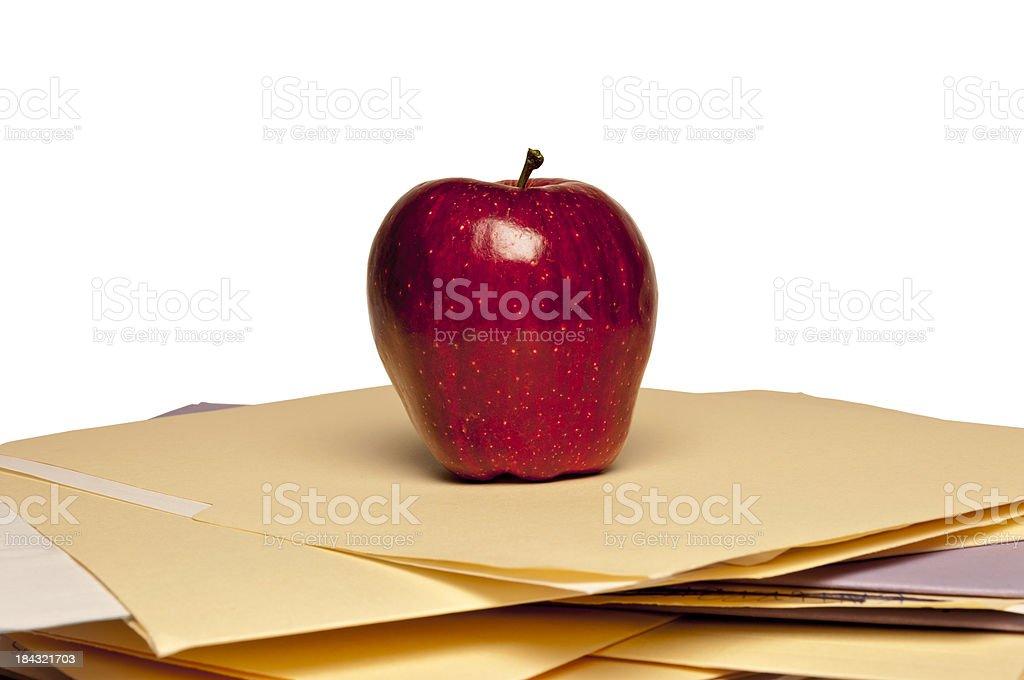 Apple On Top Of Manila Folders royalty-free stock photo
