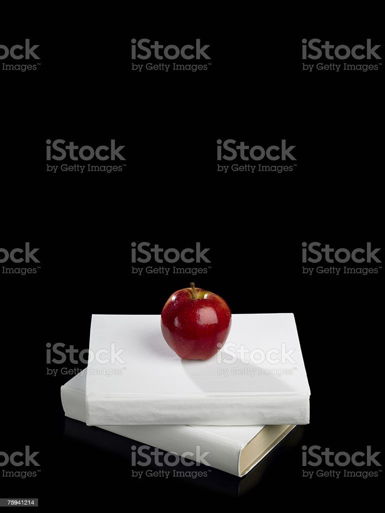 Apple on top of pile of books royalty-free stock photo