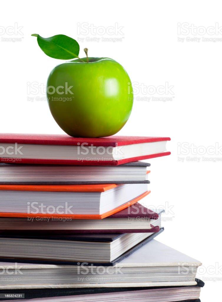 Apple on Top of School Books stock photo