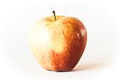 Apple on white table