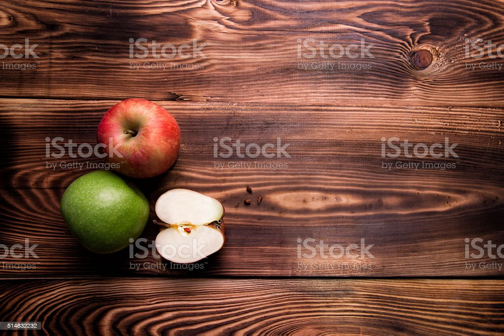 Apple on wooden background stock photo