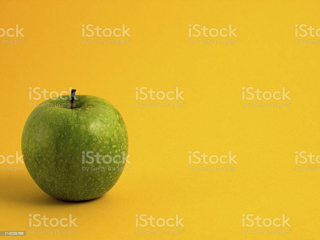 Apple on yellow royalty-free stock photo