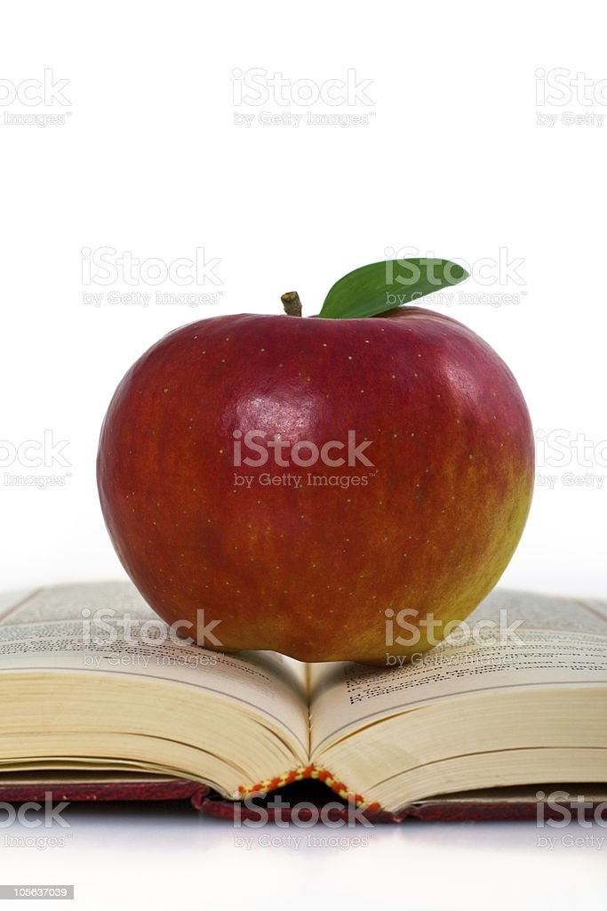Apple ont the book. royalty-free stock photo