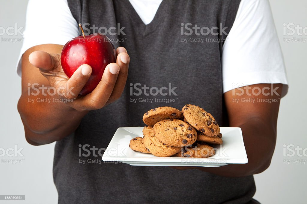 Apple or cookies your choice royalty-free stock photo