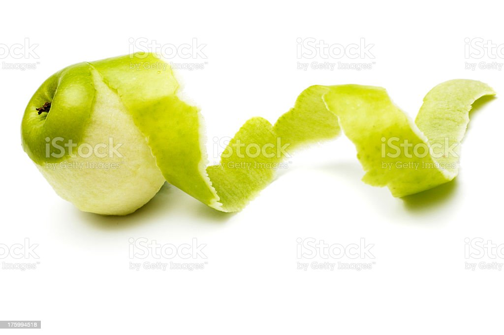 Apple peeled with twisting skin against white stock photo