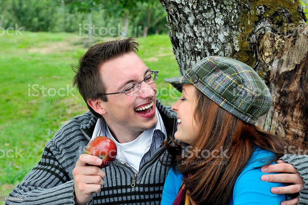 Apple Picking Couple Share a Laugh royalty-free stock photo