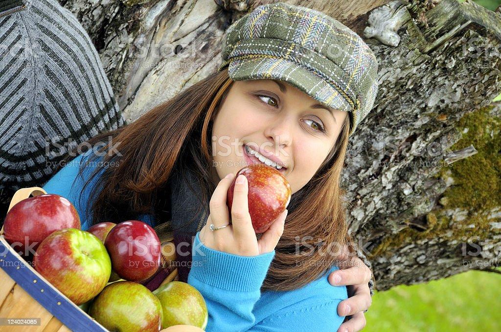 Apple Picking Girl Ready to Take a Bite royalty-free stock photo