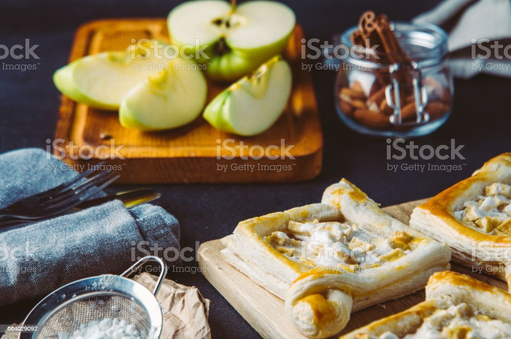 Apple pie and ingredients. Shooting in the dark style stock photo