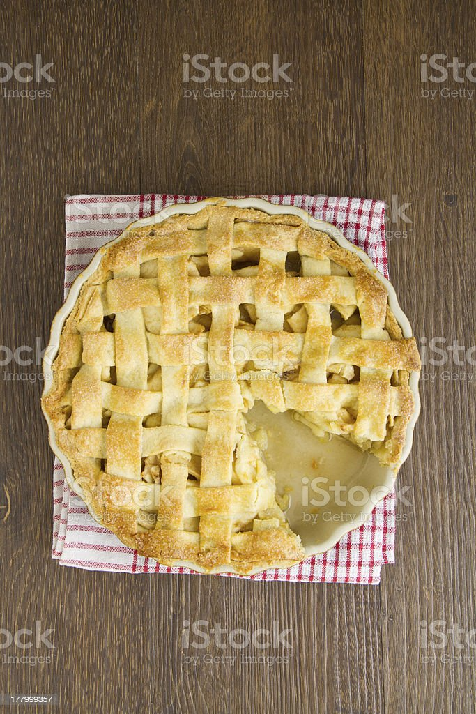 Apple pie lattice top with slice taken royalty-free stock photo