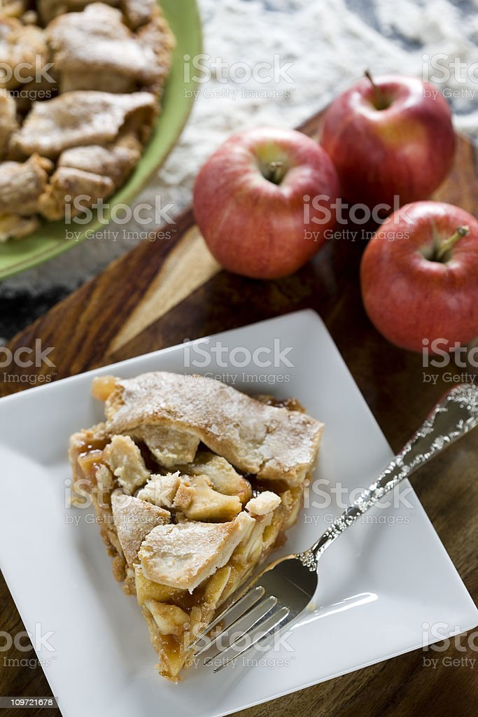 Apple Pie Slice with Flour in Blurred Background, Copyspace royalty-free stock photo