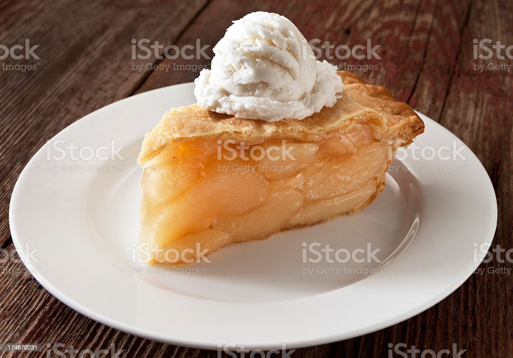 Apple Pie Slice With Ice Cream on a Rustic Background. royalty-free stock photo