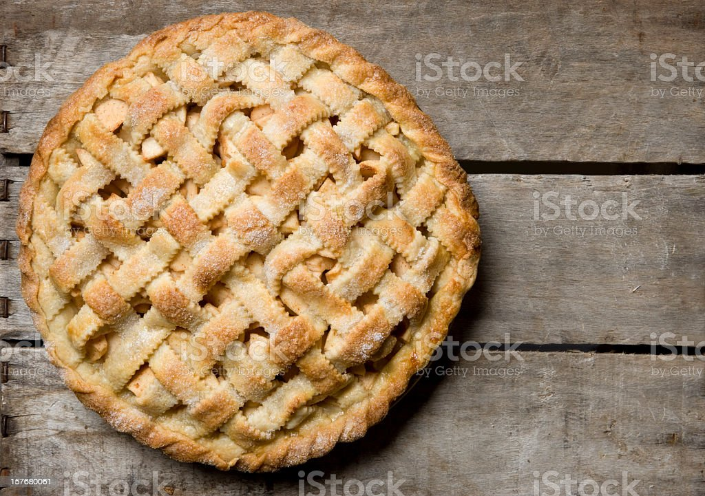 Apple Pie With Lattice Crust on a Rustic Wooden Crate. stock photo
