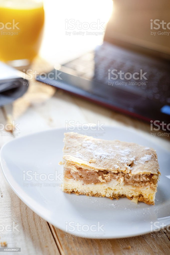 Apple pie with netbook for lunch royalty-free stock photo