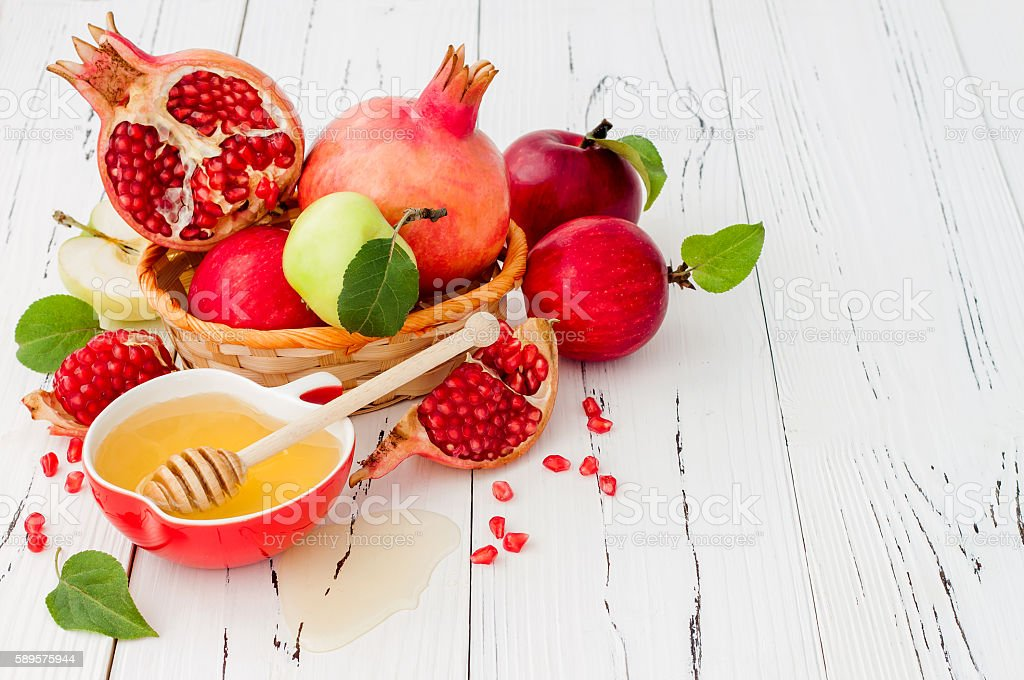 Apple, pomegranate and honey, jewish New Year Rosh Hashana food. stock photo