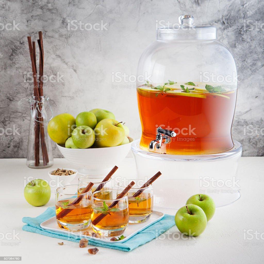 Apple punch, cider in beverage dispenser stock photo