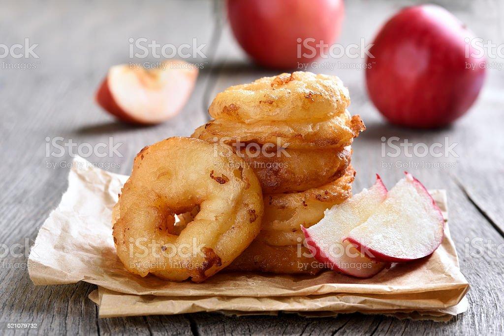 Apple rings over baking paper stock photo