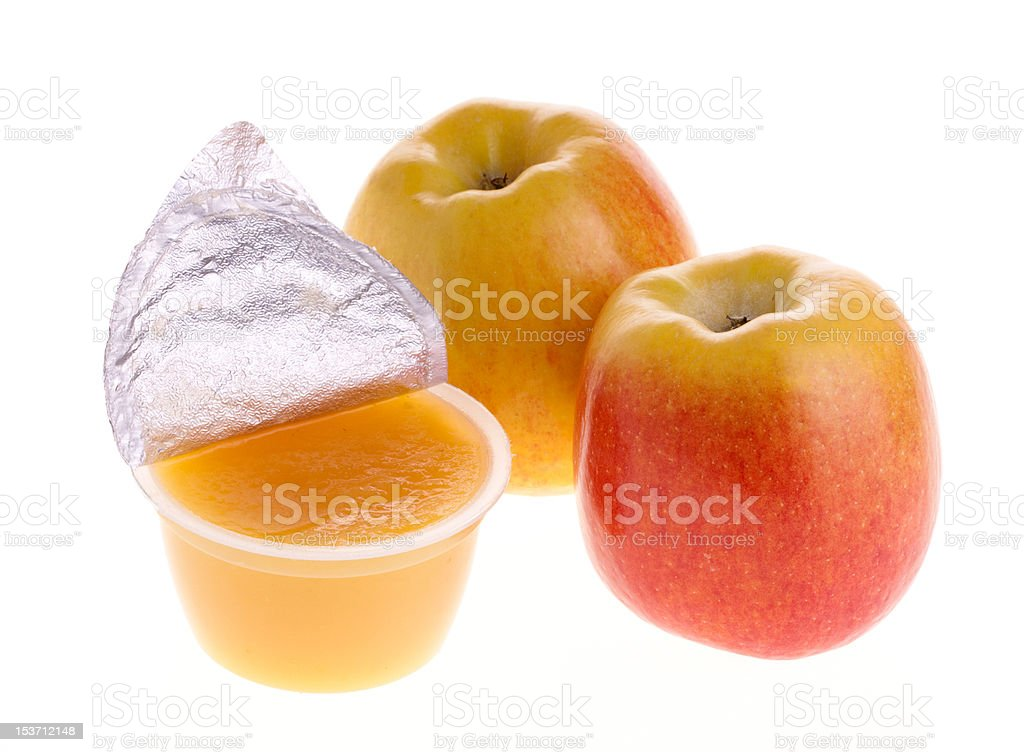 Apple sauce and two fresh apples stock photo