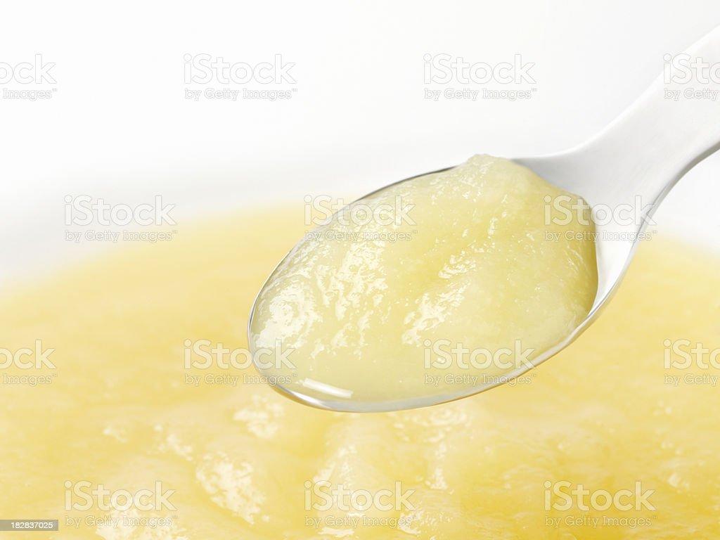 Apple Sauce Baby Food on a Spoon stock photo