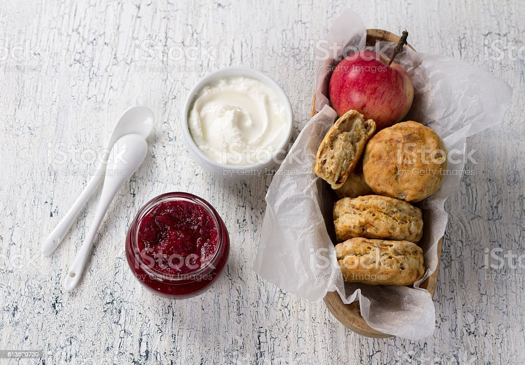 Apple scones with cream cheese and cranberry jam stock photo