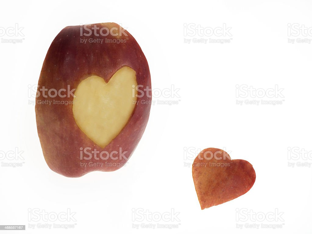 Apple slice with heart symbol stock photo