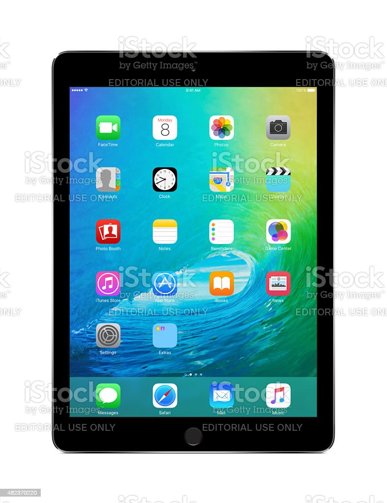 Apple Space Gray iPad Air 2 with iOS 9 stock photo