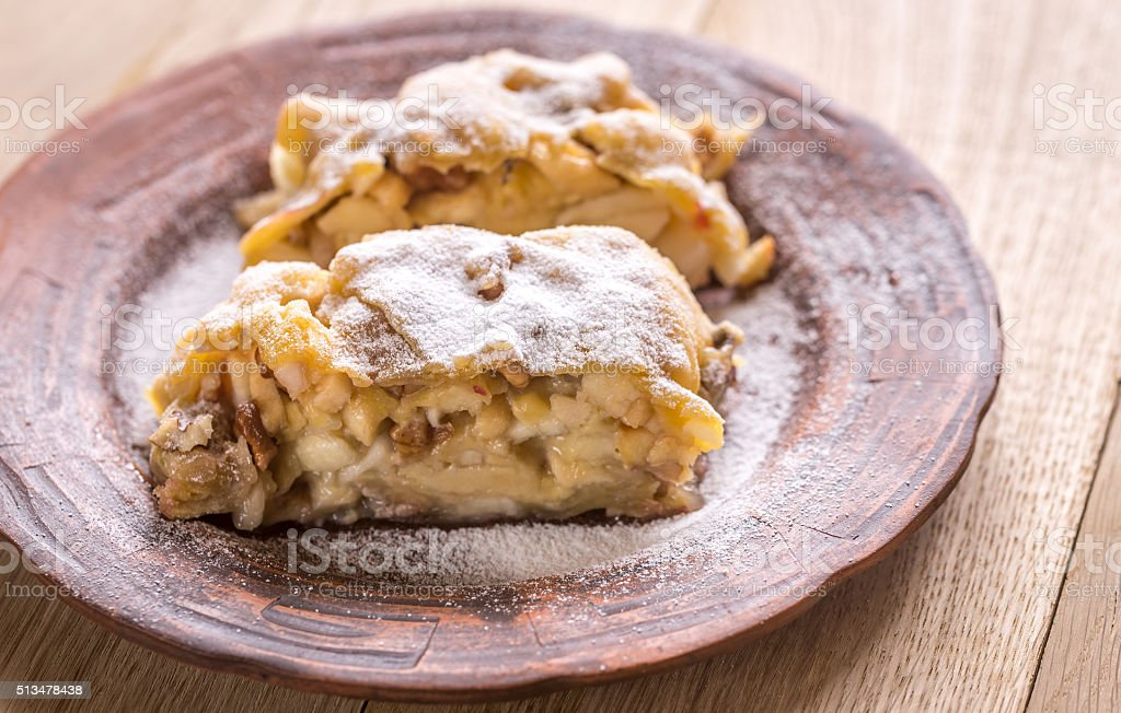 Apple strudel with walnuts stock photo