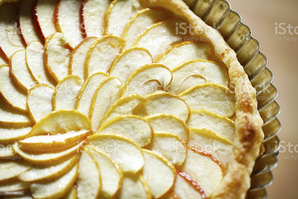 Apple tart detail with slices fanned in a pattern stock photo