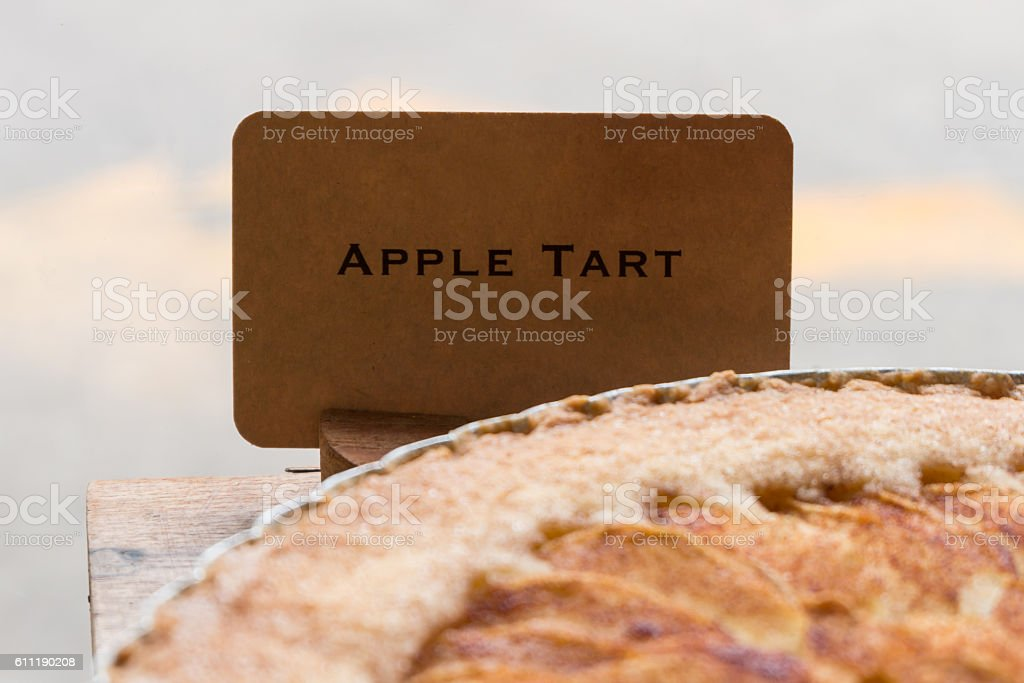 Apple tart with price tag on sale in shop stock photo