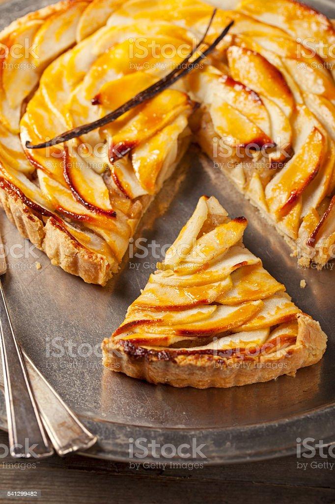 Apple tart with vanilla pod. Traditional holiday dessert stock photo