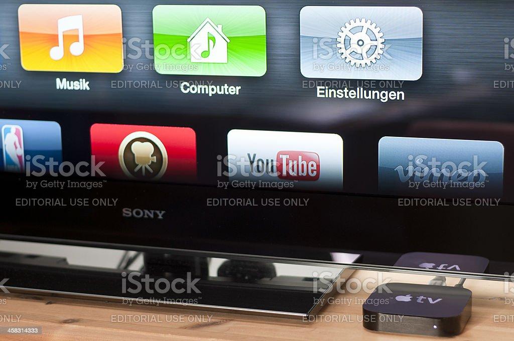 Apple TV next to a Sony Bravia royalty-free stock photo