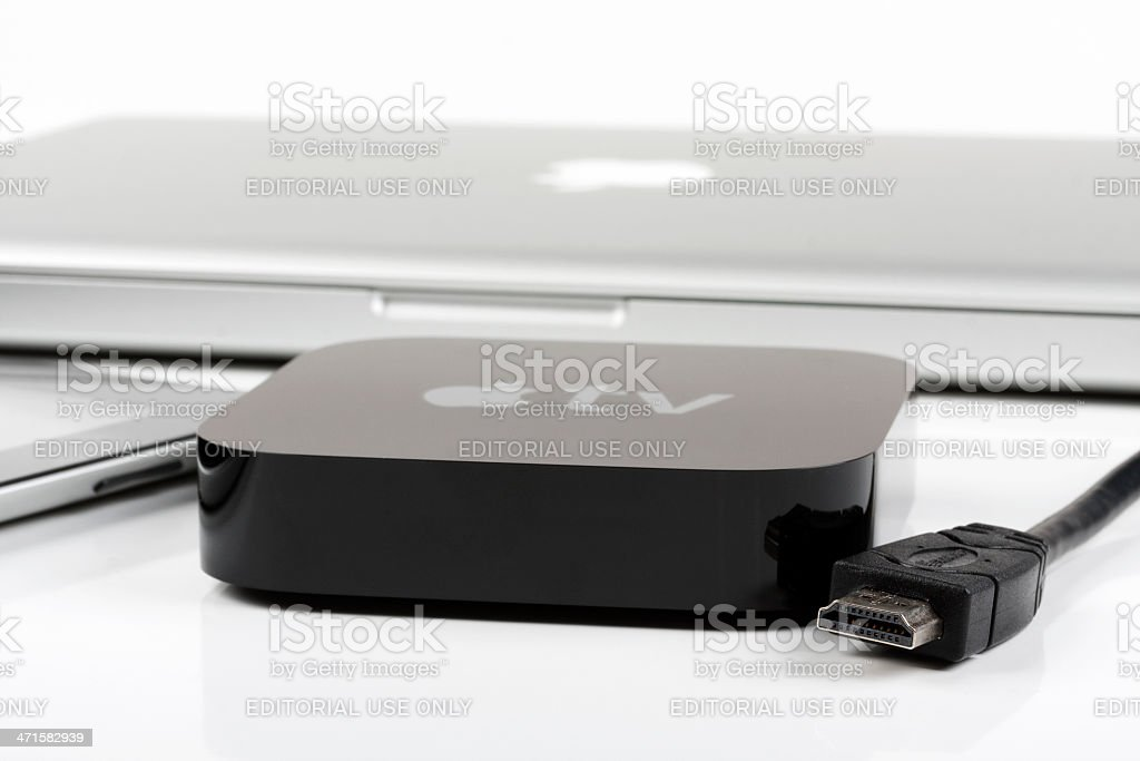 Apple TV with iPad and macbook royalty-free stock photo