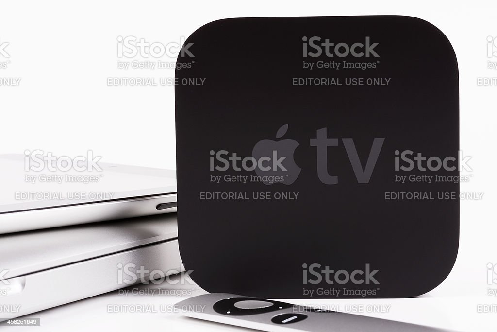 Apple TV with iPad and MacBook Pro stock photo