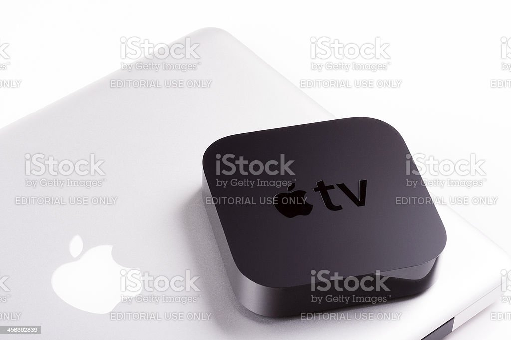 Apple TV with MacBook Pro stock photo