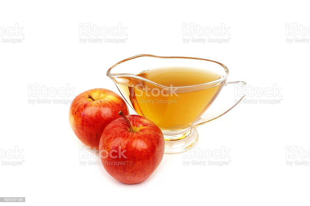 Apple vinegar and apples on white background stock photo