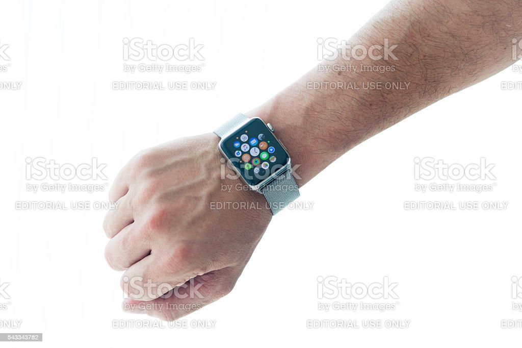 Apple Watch 42mm Stainless Silver band and man hand stock photo