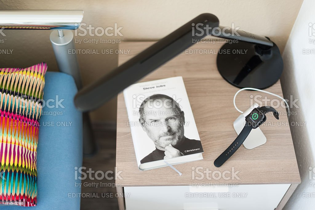 Apple Watch being charged on the bedside table stock photo