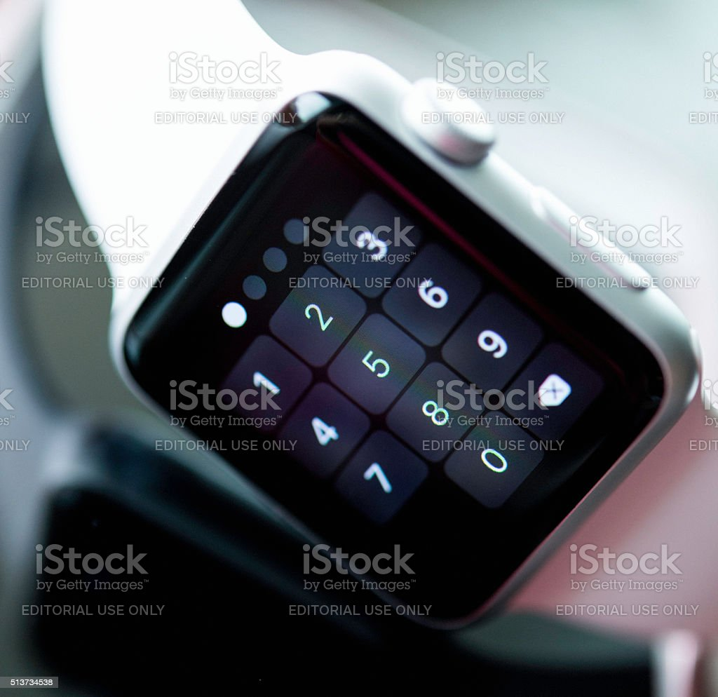 Apple watch face showing passcode screen stock photo