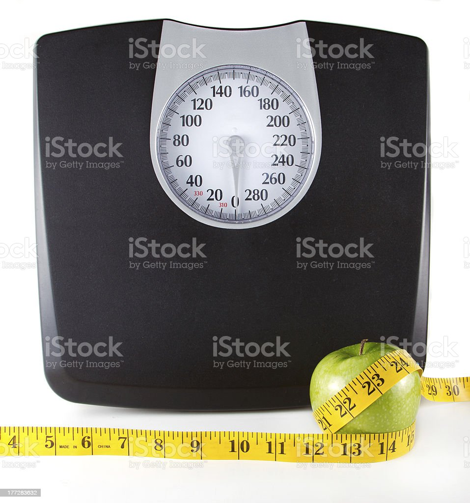 Apple with a measuring tape and scale royalty-free stock photo