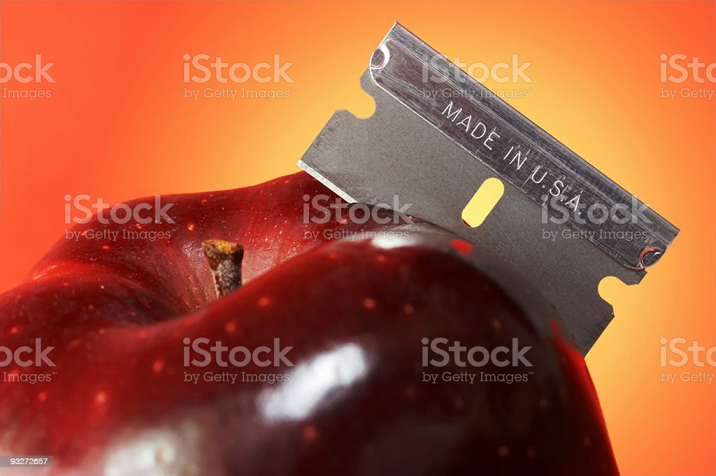 Apple With a Razor Blade stock photo